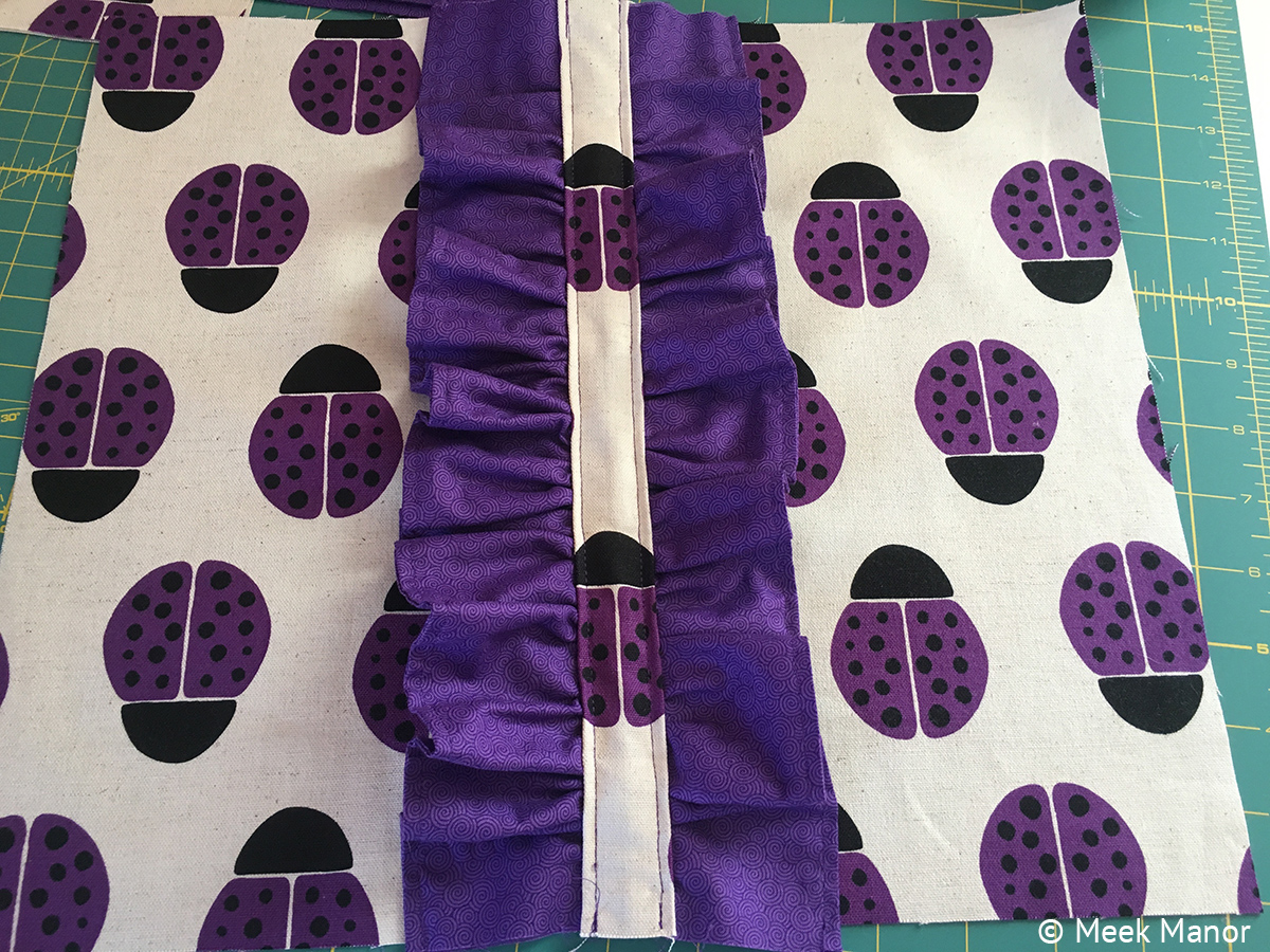 In progress--ruffle sewn on front of bag. Aren't the ladybug's fabulous?